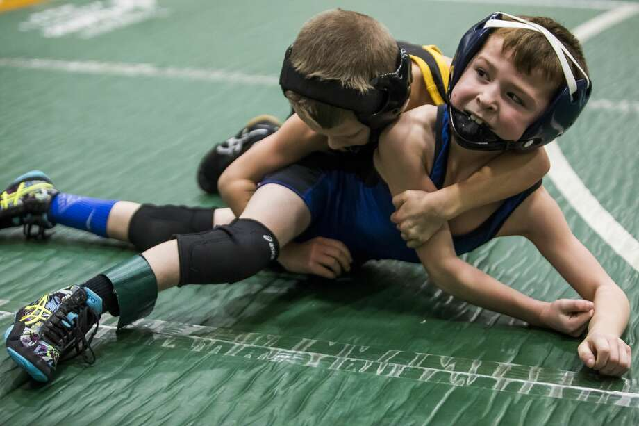 Maison Woodruff, right, wrestles an opponent during the NEMWA Youth Wrestling League Regional Tournament on Saturday, Feb. 16, 2019 at Freeland High School. (Katy Kildee/kkildee@mdn.net) Photo: (Katy Kildee/kkildee@mdn.net)