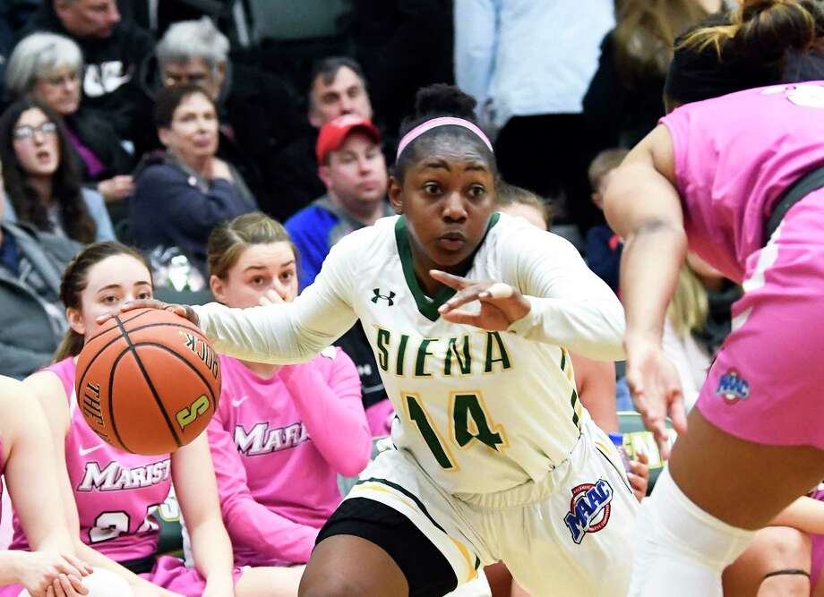 Siena guard Joella Gibson (14) moves the ball against the Marist during the first half of an NCAA women's college basketball game Friday, Feb. 1, 2019, in Loudonville, N.Y. (Hans Pennink / Special to the Times Union) Photo: Hans Pennink / 40046056A