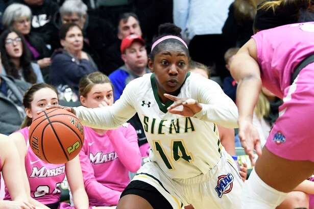 Siena guard Joella Gibson (14) moves the ball against the Marist during the first half of an NCAA women's college basketball game Friday, Feb. 1, 2019, in Loudonville, N.Y. (Hans Pennink / Special to the Times Union)
