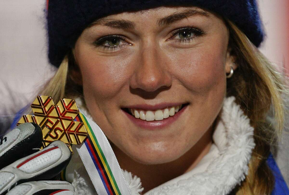 Gold medal's winner United States' Mikaela Shiffrin poses during the medals ceremony for the women's slalom, at the alpine ski World Championships in Are, Sweden, Saturday, Feb. 16, 2019. (AP Photo/Giovanni Auletta)