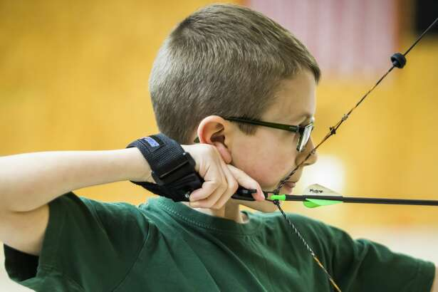 Dylan Workman of Midland, 11, takes aim with his bow during a youth archery event on Saturday, Feb. 16, 2019 at Mid Michee Bowmen in Midland. (Katy Kildee/kkildee@mdn.net)