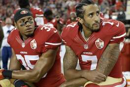 FILE - In this Sept. 12, 2016, file photo, San Francisco 49ers safety Eric Reid (35) and quarterback Colin Kaepernick (7) kneel during the national anthem before an NFL football game against the Los Angeles Rams, in Santa Clara, Calif. Colin Kaepernick and Eric Reid have reached settlements on their collusion lawsuits against the NFL, the league said Friday, Feb. 19, 2019.(AP Photo/Marcio Jose Sanchez, File)