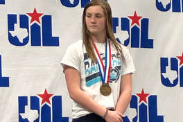 Greenwood freshman Grace Austin stands on the podium after placing third in the Class 5A girls 1-meter at the UIL state meet, Saturday in Austin. Courtesy photo