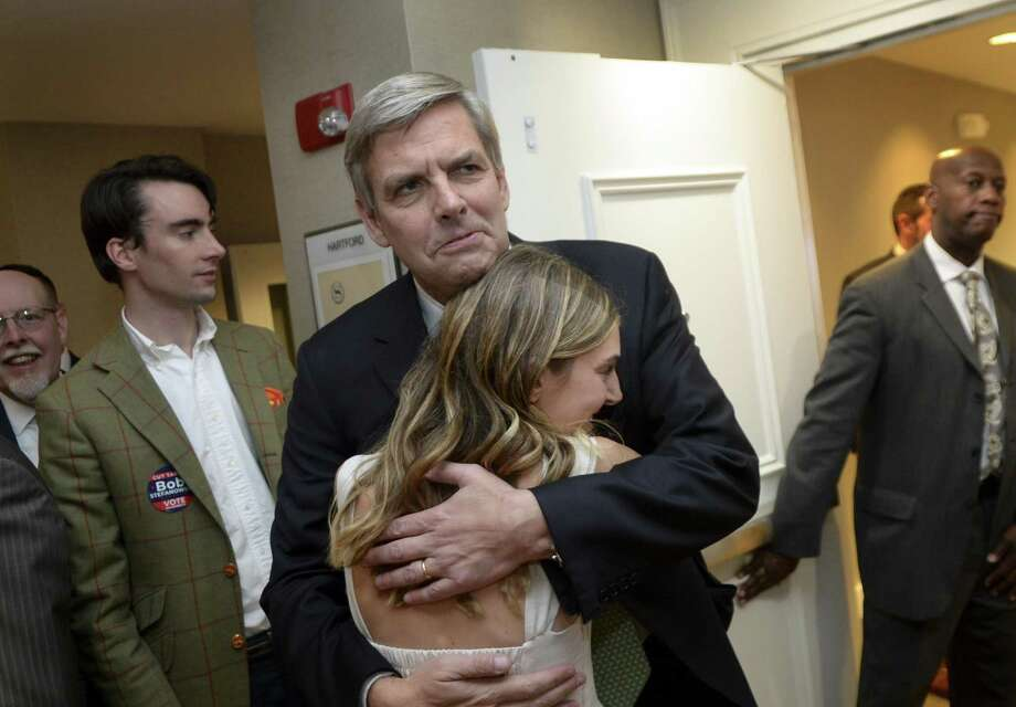 Republican gubernatorial candidate Bob Stefanowski hugs his daughter Rachel at an election night party, Tuesday, Nov. 6, 2018, in Rocky Hill, Conn. Did Stefanowski consider running as a Democrat? Photo: Stephen Dunn / Associated Press / Copyright 2018 The Associated Press. All rights reserved