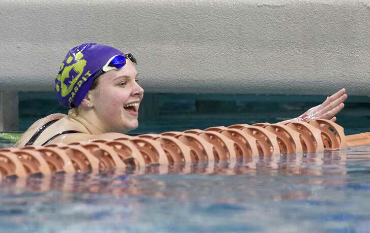 JoJo Daspit of Montgomery reacts after winning the Class 5A girls 100-yard freestyle during the UIL State Swimming & Diving Championships at the Lee & Joe Jamail Texas Swimming Center, Saturday, Feb. 16, 2019, in Austin.