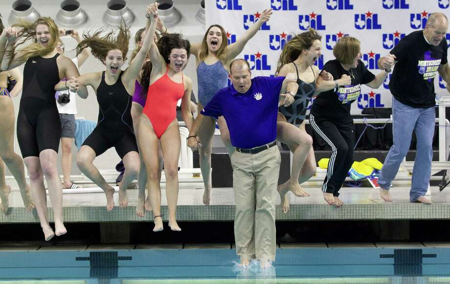 Montgomery swimmers celebrate after winning the Class 5A girls team title during the UIL State Swimming & Diving Championships at the Lee & Joe Jamail Texas Swimming Center, Saturday, Feb. 16, 2019, in Austin. Photo: Jason Fochtman, Houston Chronicle / Staff Photographer / © 2019 Houston Chronicle