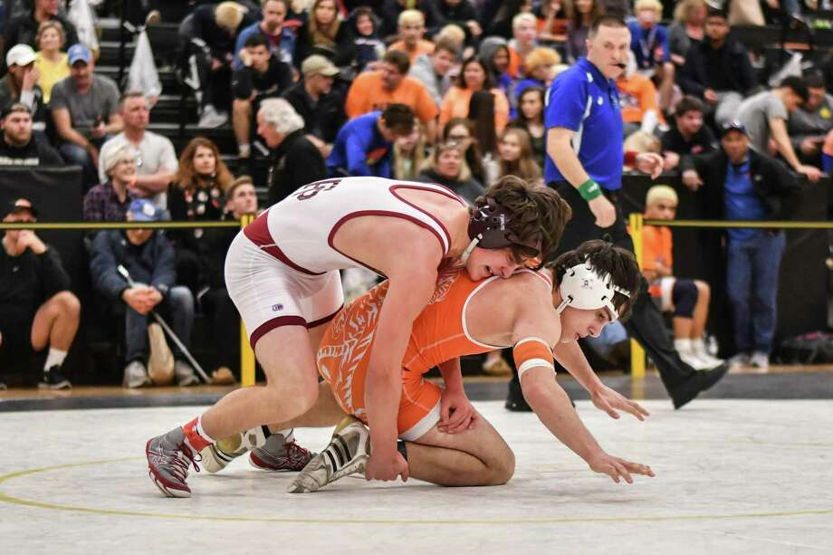 Dean Tsiranides of the Fairfield Prep Jesuits and Lazar Agoev of the Ridgefield Tigers wrestle in the 160lb weight class during the CIAC Class LL finals on Saturday February 16, 2019 at Trumbull High School in Trumbull, Connecticut. Photo: Gregory Vasil / For Hearst Connecticut Media / Connecticut Post Freelance