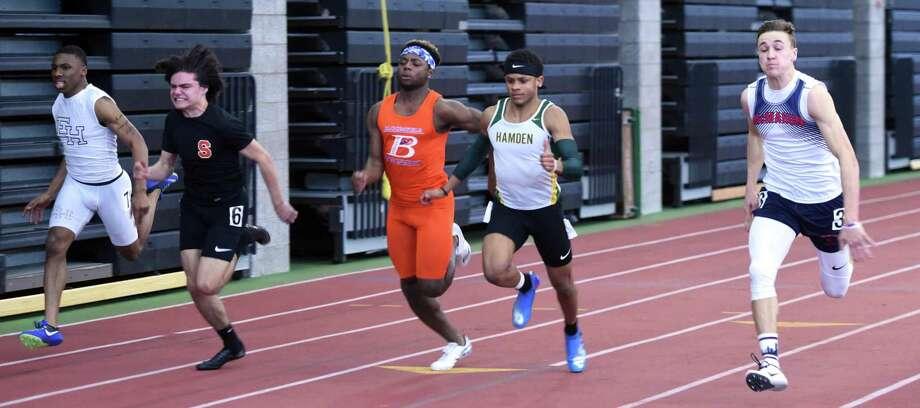 Hamden's Christopher Pigatt, center, won the 55-meter dash at last season's State Open. Photo: Arnold Gold / Hearst Connecticut Media / New Haven Register