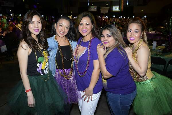 A group of people at the The Southeast Texas Circle of Hope's Pardi Gras celebration at the Beaumont Civic Center on Saturday. Photo taken on Saturday, 02/16/19. Ryan Welch/The Enterprise