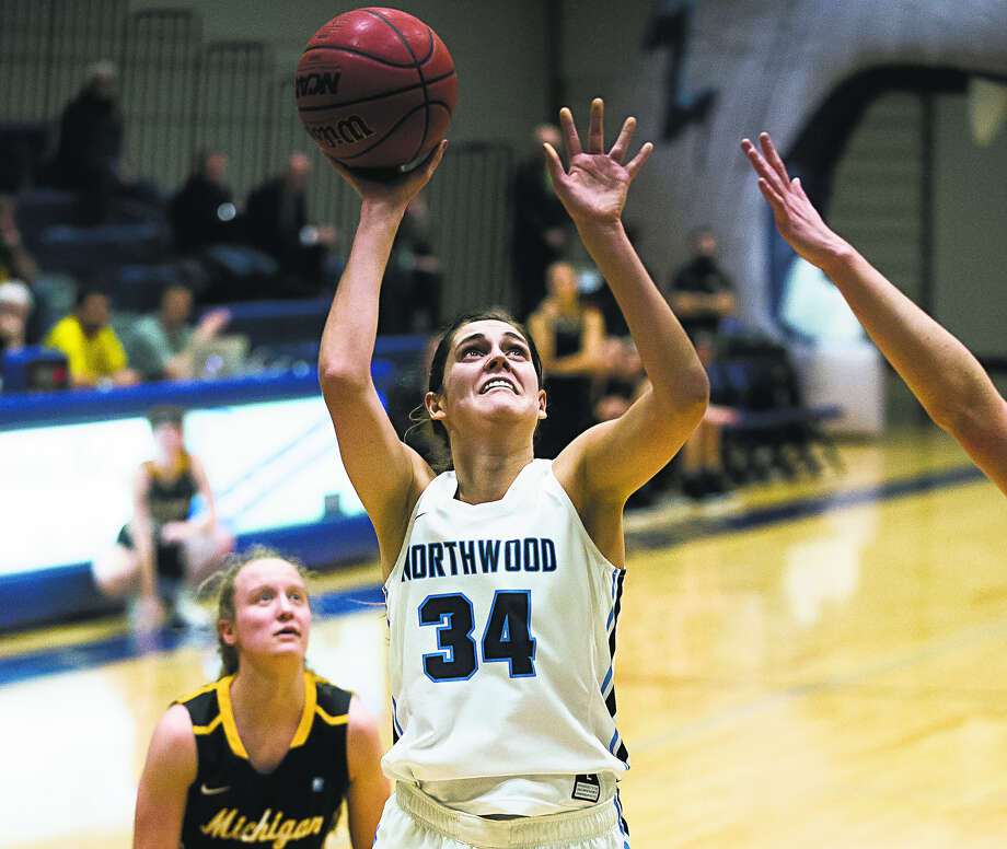 Northwood's Grace German goes up for a shot against Michigan Tech earlier this season. German scored a career-high 25 points on Saturday, as the Timberwolves came heartbreakingly close to knocking off 12th-ranked Grand Valley. Photo: Daily News File Photo