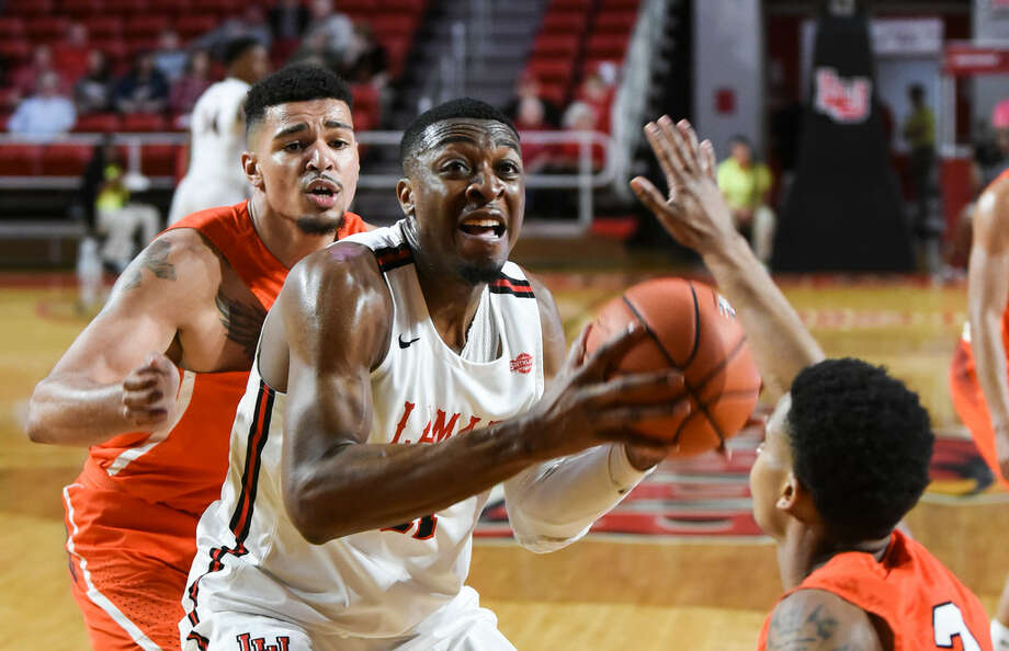 Lamar's Josh Nzeakor looks to take a shot while a couple of Sam Houston players defend during the first period of the game at the Montagne Center on Saturday.