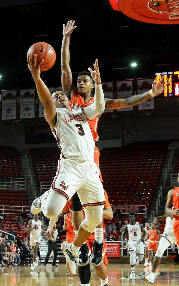 Lamar's Nick Garth goes for a layup during first period of the game at the Montagne Center on Saturday. Photo taken on Saturday, 02/16/19. Ryan Welch/The Enterprise Photo: Ryan Welch