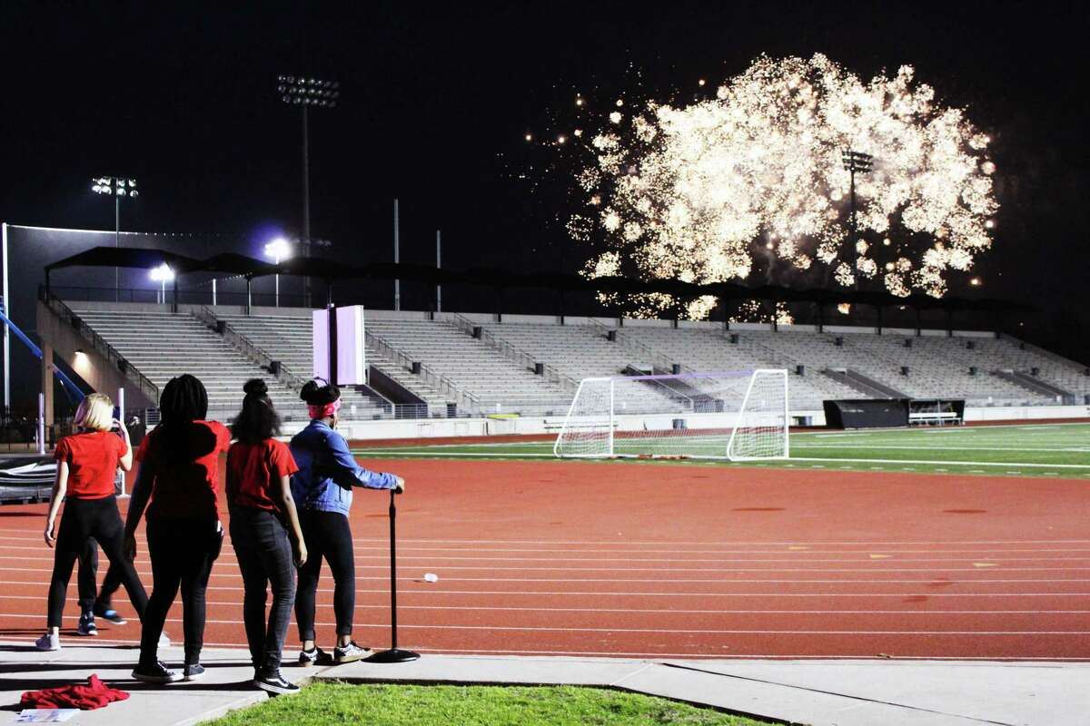 Woodcreek Middle School students watch the display of fireworks at the Humble ISD's Centennial Celebration on Feb. 16, 2019.