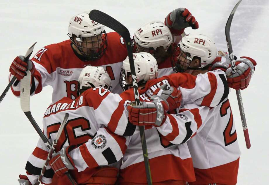 RPI hockey players celebrate their first and only goal just moments into the first period of an ECAC game against Quinnipiac at the Houston Field House on Saturday, Feb. 16, 2019 in Troy, N.Y. (Jenn March, Special to the Times Union) Photo: Jenn March / © Jenn March 2018 © Albany Times Union 2018