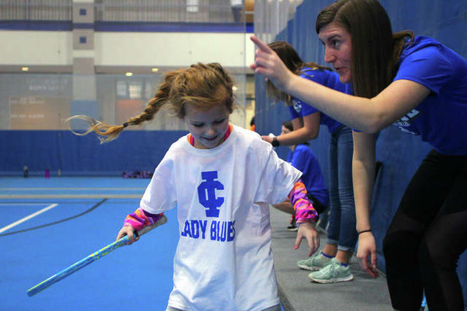 Girls try out new skills at Saturday's sports skills camp hosted by Illinois College. Photo: Rosalind Essig | Journal-Courier