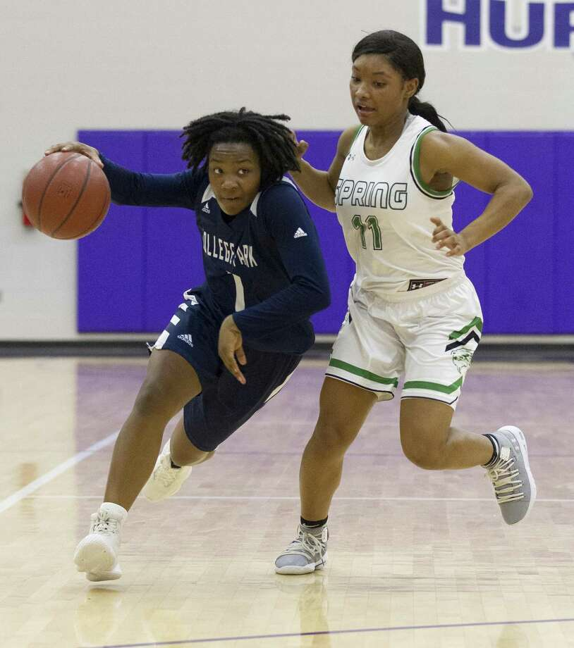 College Park guard Aalyssa Rogers (1) gets past Spring point guard Kyndal Ayro (11) during the second quarter of a Region II-6A bi-district high school basketball game at Klein Cain High School, Monday, Feb. 11, 2019, in Houston. Photo: Jason Fochtman, Houston Chronicle / Staff Photographer / © 2019 Houston Chronicle