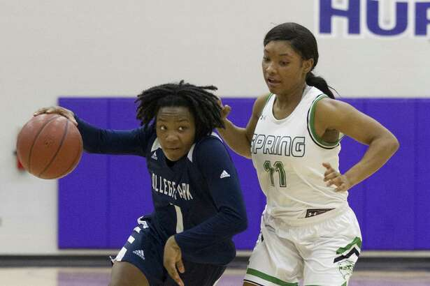 College Park guard Aalyssa Rogers (1) gets past Spring point guard Kyndal Ayro (11) during the second quarter of a Region II-6A bi-district high school basketball game at Klein Cain High School, Monday, Feb. 11, 2019, in Houston.