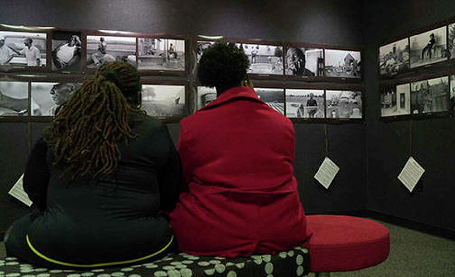 "Photographer Torsten Kjellstrand, a professor from the University of Oregon and graduate of the Missouri School of Journalism, views his ""Black Soil"" documentary photography exhibit. Moore's relatives are featured in Kjellstrand's photos. Photo: N. Andrew Dent III 