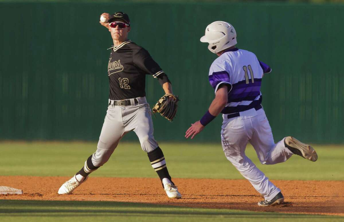 Conroe Derek Berg (12) played second base last year, but will move to catcher this season.