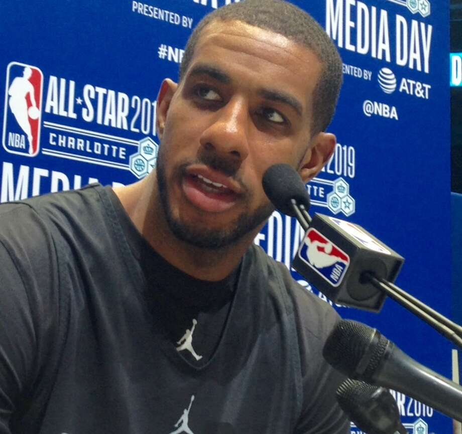 Spurs center LaMarcus Aldridge answers a question at All-Star Media Day in Charlotte. Photo: Tom Orsborn/Staff