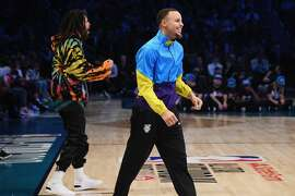 CHARLOTTE, NC - FEBRUARY 16:  J. Cole and Stephen Curry react at the AT&T Slam Dunk during the 2019 State Farm All-Star Saturday Night at Spectrum Center on February 16, 2019 in Charlotte, North Carolina.  (Photo by Kevin Mazur/WireImage)