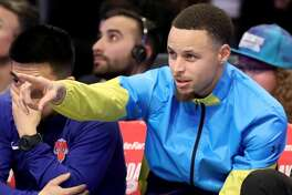 CHARLOTTE, NORTH CAROLINA - FEBRUARY 16: Stephen Curry #30 of the Golden State Warriors looks on during the AT&T Slam Dunk as part of the 2019 NBA All-Star Weekend at Spectrum Center on February 16, 2019 in Charlotte, North Carolina. (Photo by Streeter Lecka/Getty Images)