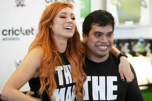 WWE wrestler Becky Lynch, left, poses for a photo with fan Miguel de la Pena of Houston during an appearance at Cricket Wireless, 8307 Beechnut St., Sunday, Feb. 17, 2019, in Houston.