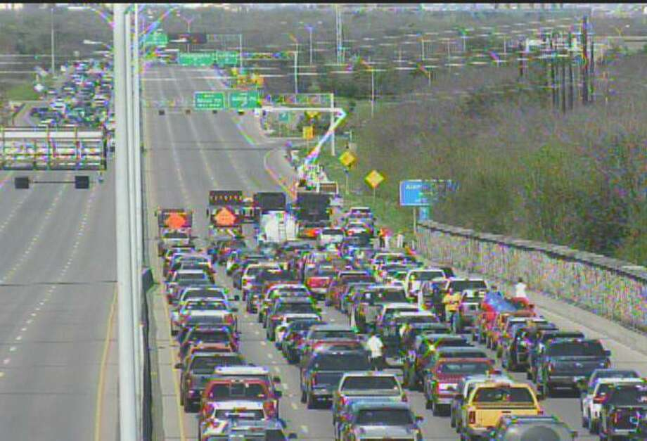 Motorists continue to deal with congestion from scheduled work on electrical lines along U.S. 281 near Basse Road Sunday afternoon, Feb 17, 2019. Photo: Screen Grab Texas Department Of Transportation