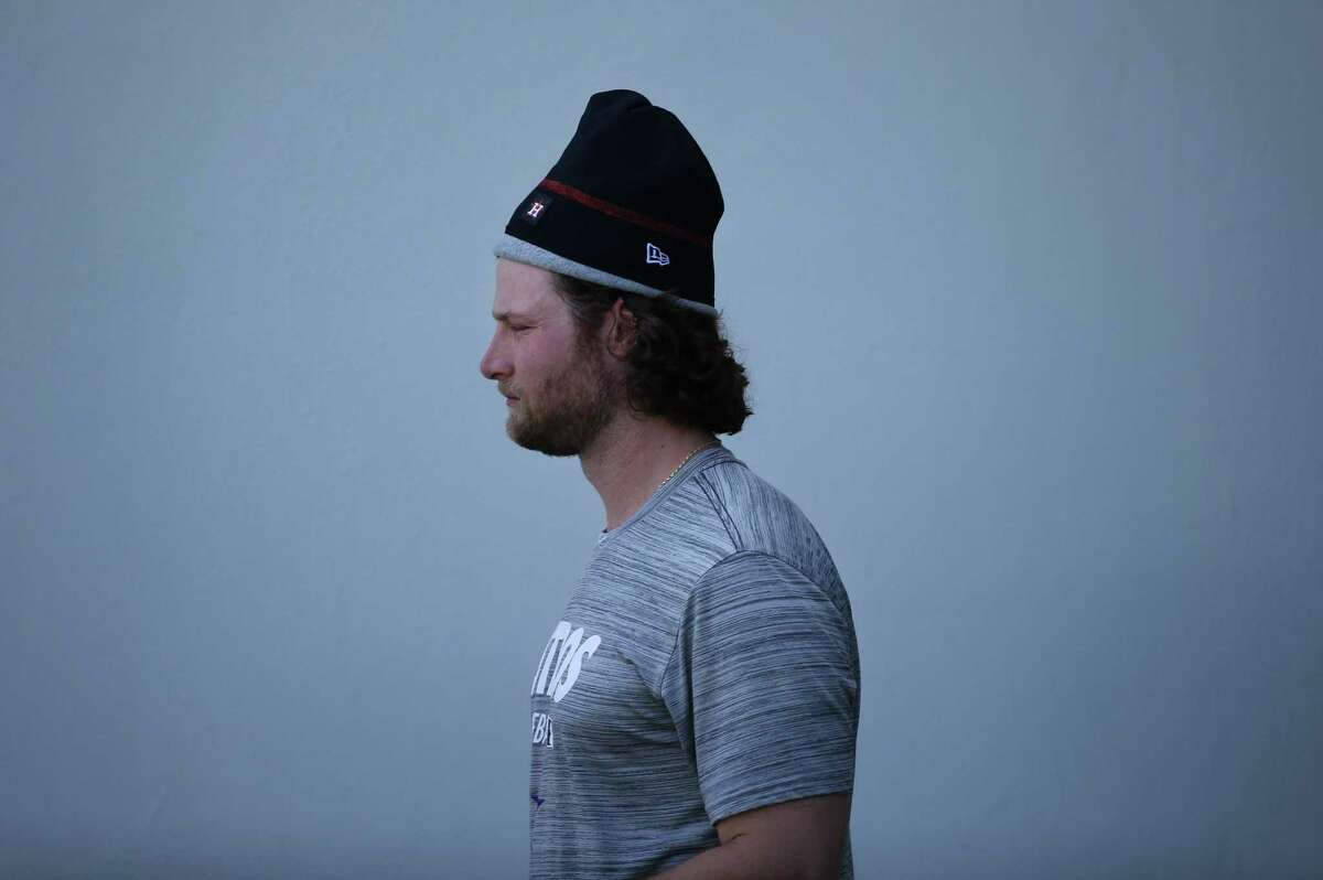 Houston Astros right handed pitcher Gerrit Cole (45) walks out from the clubhouse with a beanie hat at Fitteam Ballpark of The Palm Beaches on Day 4 of spring training on Sunday, Feb. 17, 2019, in West Palm Beach.