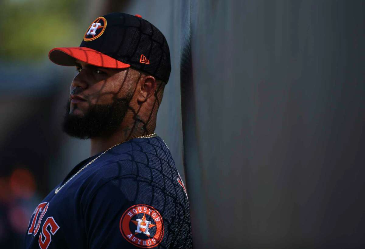 Houston Astros right handed pitcher Francis Martes (58) takes some time for himself against the fence during the warm-up session at Fitteam Ballpark of The Palm Beaches on Day 4 of spring training on Sunday, Feb. 17, 2019, in West Palm Beach.