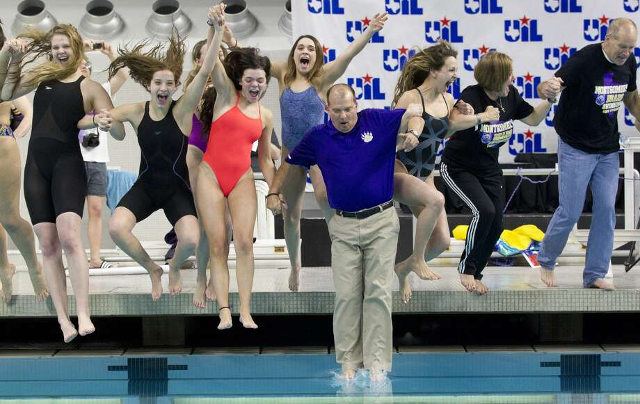Montgomery swimmers celebrate after winning the Class 5A girls team title during the UIL State Swimming & Diving Championships at the Lee & Joe Jamail Texas Swimming Center, Saturday, Feb. 16, 2019, in Austin. Photo: Jason Fochtman/Staff Photographer