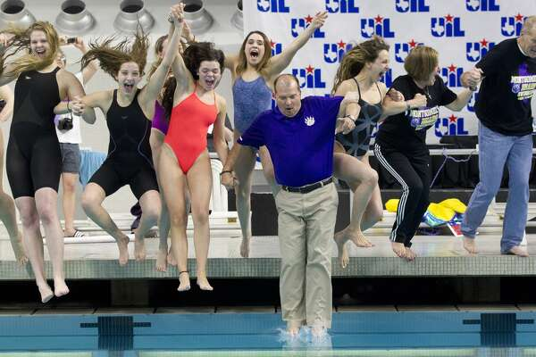 Montgomery swimmers celebrate after winning the Class 5A girls team title during the UIL State Swimming & Diving Championships at the Lee & Joe Jamail Texas Swimming Center, Saturday, Feb. 16, 2019, in Austin.