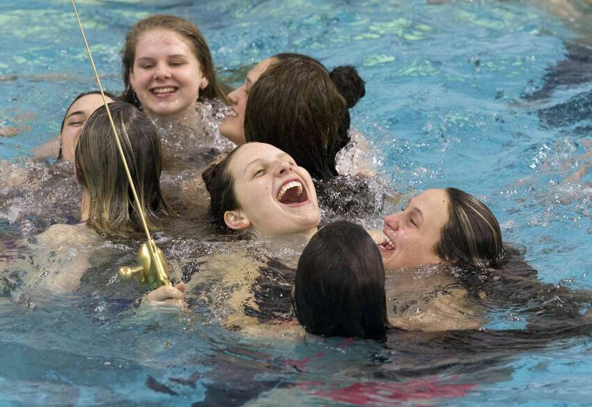 Kaitlynn Sims of Montgomery, center, celebrates with teammates after winning the Class 5A girls team title during the UIL State Swimming & Diving Championships at the Lee & Joe Jamail Texas Swimming Center, Saturday, Feb. 16, 2019, in Austin. Sims set a Class 5A state record in the girls 500-yard freestyle.
