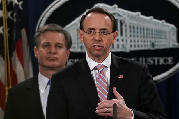 """U.S. Deputy Attorney General Rod Rosenstein announces a China related national security law enforcement action in this December 20, 2018 file photo at the Justice Department in Washington, DC.Former acting FBI director Andrew McCabe said Rosenstein raised the idea of using the 25th Amendment to remove Trump from office an a """"60 Minutes"""" interview out on Feb. 17, 2019."""