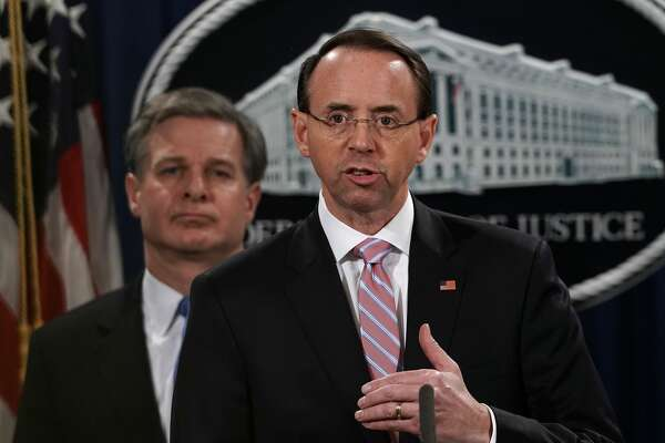 "U.S. Deputy Attorney General Rod Rosenstein announces a China related national security law enforcement action in this December 20, 2018 file photo at the Justice Department in Washington, DC. Former acting FBI director Andrew McCabe said Rosenstein raised the idea of using the 25th Amendment to remove Trump from office an a ""60 Minutes"" interview out on Feb. 17, 2019."