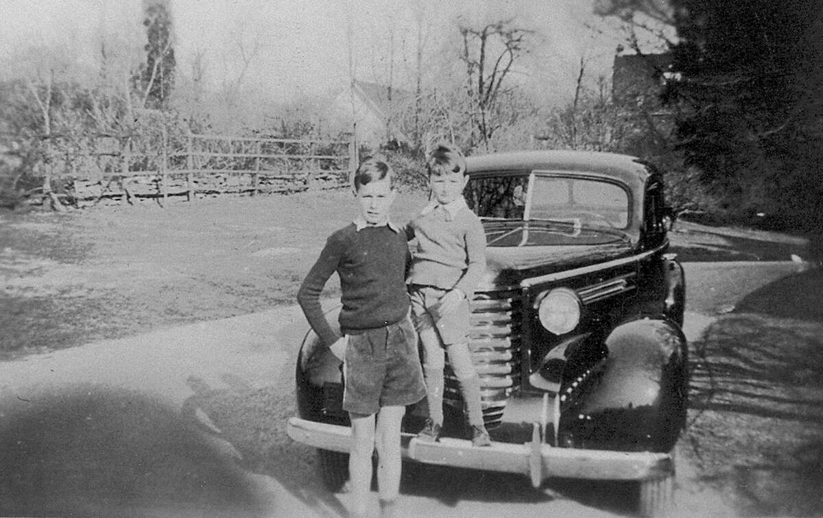 Future President George Bush, left, with his brother John, at their home in Greenwich in the 1930s. George was 13 at the time and his brother was 6.