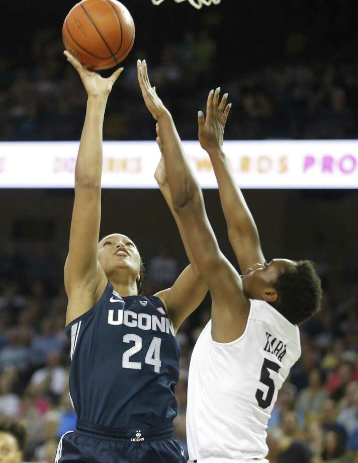 UConn's Napheesa Collier (24) shoots over UCF's Masseny Kaba during the first quarter on Sunday. Photo: Reinhold Matay / Associated Press / Reinhold Matay