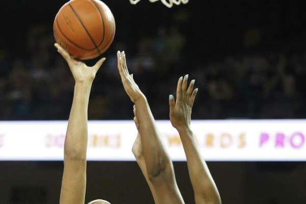 UConn's Napheesa Collier (24) shoots over UCF's Masseny Kaba during the first quarter on Sunday.