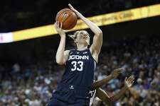 UConn's Katie Lou Samuelson drives to the basket against UCF on Sunday.