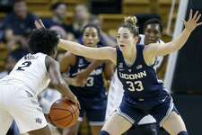 UConn's Katie Lou Samuelson (33) guards UCF's Korneila Wright during the first quarter Sunday.