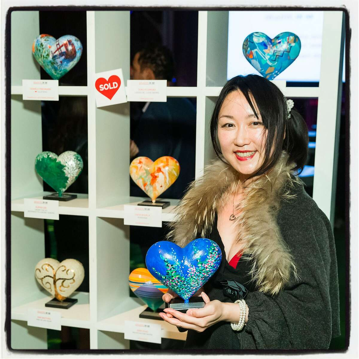 """""""Hearts in SF"""" artist Taiko Fujimura with her sculpture at Pier 48. Feb. 13, 2019."""