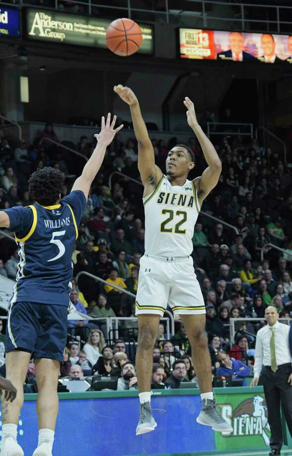 Jalen Pickett of Siena puts up a shot over Tyrese Williams of Quinnipiac during their game on Sunday, Feb. 17, 2019, in Albany, N.Y.    (Paul Buckowski/Times Union) Photo: Paul Buckowski, Albany Times Union / (Paul Buckowski/Times Union)