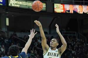 Jalen Pickett of Siena puts up a shot over Tyrese Williams of Quinnipiac during their game on Sunday, Feb. 17, 2019, in Albany, N.Y.    (Paul Buckowski/Times Union)