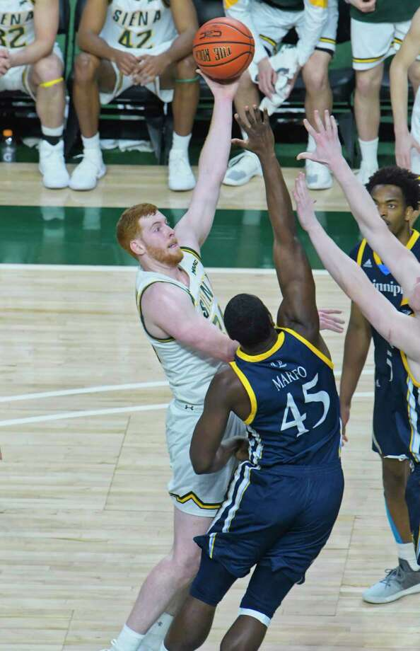 Kevin Degnan of Siena, left, puts up a shot over Kevin Marfo of Quinnipiac during their game on Sunday, Feb. 17, 2019, in Albany, N.Y.    (Paul Buckowski/Times Union) Photo: Paul Buckowski, Albany Times Union / (Paul Buckowski/Times Union)