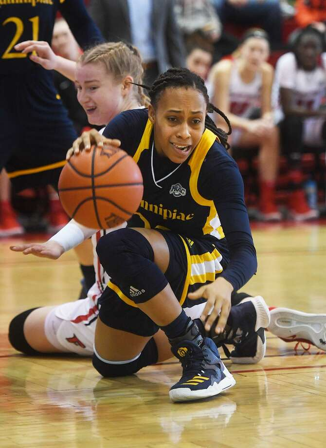 Quinnipiac's Brittany Martin dribbles the ball in front of Fairfield defender Katie Armstrong in the first half Sunday. Photo: Brian A. Pounds / Hearst Connecticut Media / Connecticut Post