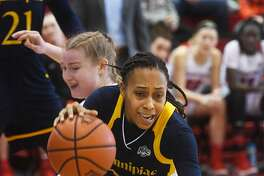 Quinnipiac's Brittany Martin dribbles the ball in front of Fairfield defender Katie Armstrong in the first half Sunday.