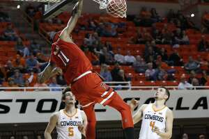 Texas Tech forward Tariq Owens (11) dunks in front of Oklahoma State forward Duncan Demuth (5) and guard Thomas Dziagwa (4) in the second half of an NCAA college basketball game in Stillwater, Okla., Wednesday, Feb. 13, 2019. (AP Photo/Sue Ogrocki)