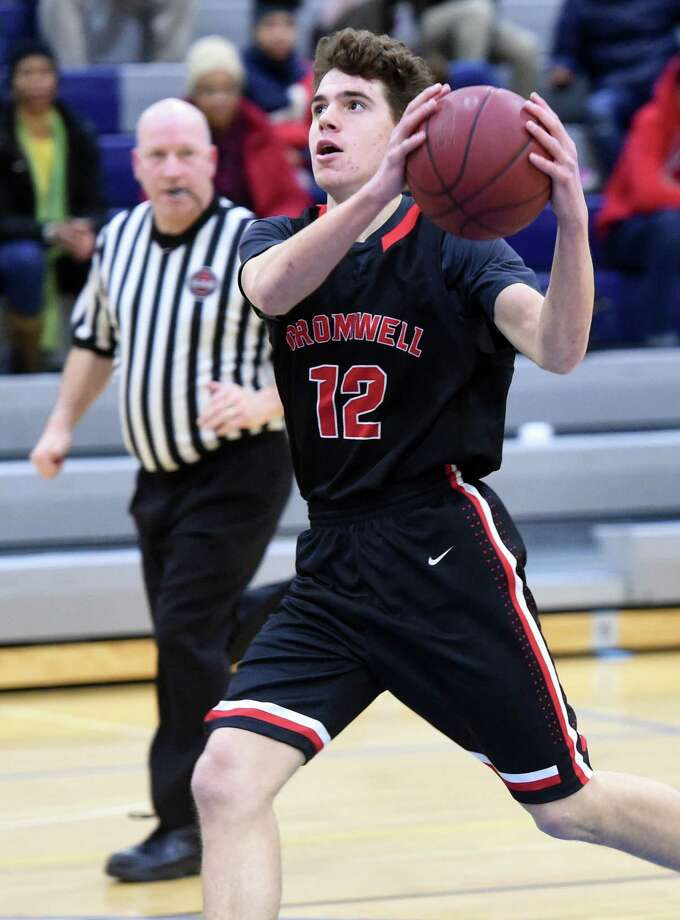 The Cromwell boys basketball team will take aim at the first 20-0 regular season in John Pinone's nearly two decades as coach when they take on 16-2 Old Lyme on Monday. Photo: Arnold Gold / Hearst Connecticut Media / New Haven Register
