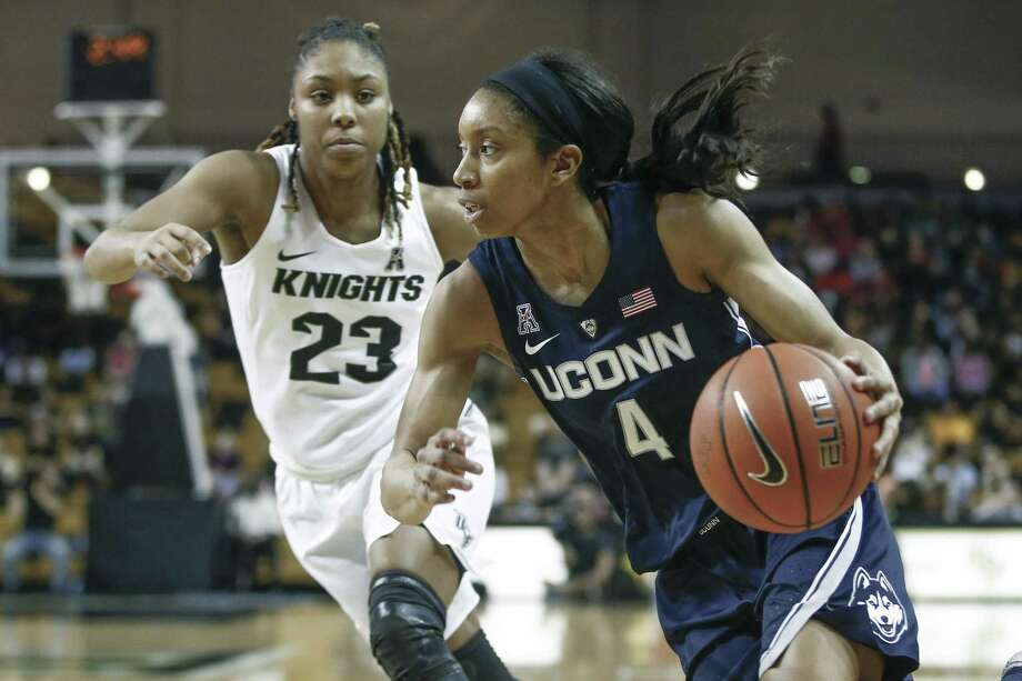 UConn guard Mikayla Coombs (4) drives past Central Florida guard Lawriell Wilson (23) during the second half of an NCAA college basketball game in Orlando, Fla., on Sunday, Feb. 17, 2019. Photo: Reinhold Matay / Associated Press / Reinhold Matay