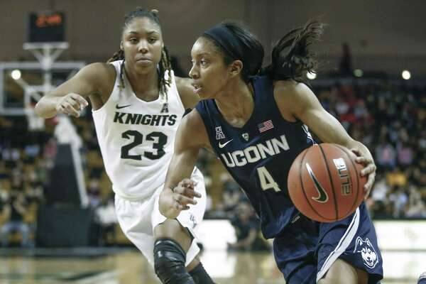 UConn guard Mikayla Coombs (4) drives past Central Florida guard Lawriell Wilson (23) during the second half of an NCAA college basketball game in Orlando, Fla., on Sunday, Feb. 17, 2019.